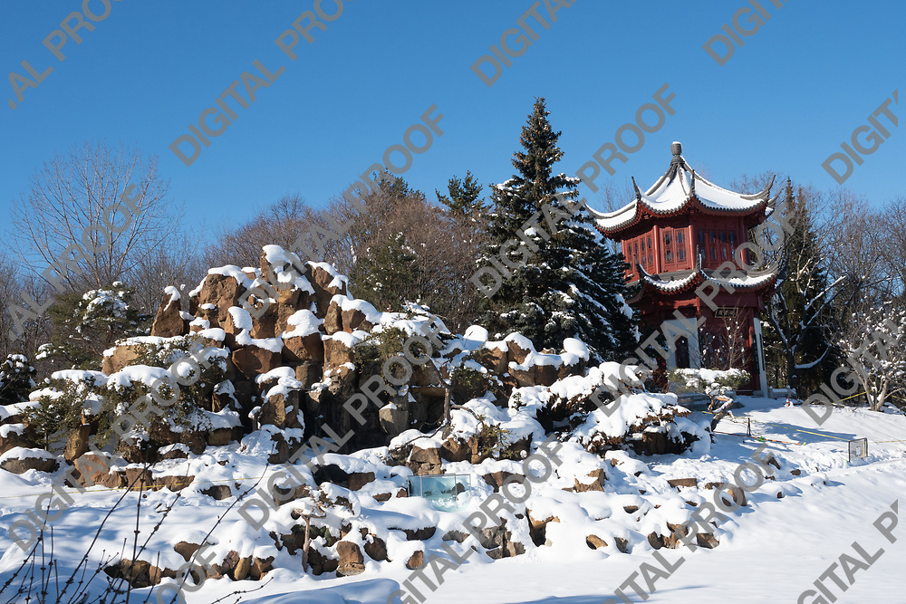 January 24, 2021 - Montreal Botanical Garden, Quebec, Canada - The Tower of Condensing Clouds at Chinese Garden in winter with snow horizontal- Montreal Botanical Garden