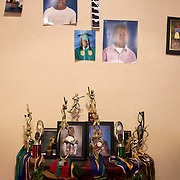 COLUMBIA, SOUTH CAROLINA - JANUARY 27: Trophies and school picutres hang on the wall in at the home of Community organizer and resident of North Pointe Estate housing complex, Tonya Isaac,  in North Columbia, SC on January 27, 2020. Tonya says it's a rule of the home that each of her 4 children played sports and other after school activities.   (Photo by Logan CyrusforThe Washington Post)