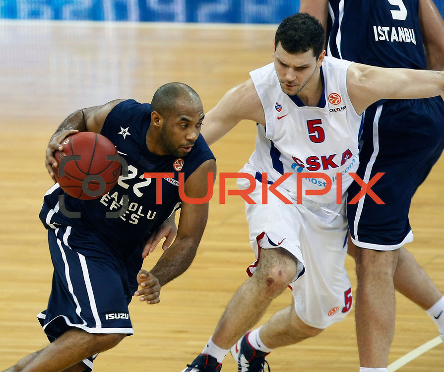 Anadolu Efes's Alfred Jamon Lucas (L) and CSKA Moscow's Vladimir Micov (R) during their Euroleague Top 16 game 8 basketball match Anadolu Efes between CSKA Moscow at the Abdi Ipekci Arena in Istanbul at Turkey on Friday, February, 22, 2013. Photo by TURKPIX