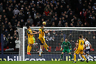 Shane Duffy of Brighton & Hove Albion (2L) attempts a header at goal. Premier league match, Tottenham Hotspur v Brighton & Hove Albion at Wembley Stadium in London on Wednesday 13th December 2017.<br /> pic by Steffan Bowen, Andrew Orchard sports photography.