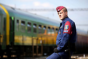 A police officer is seen at Bicske train station in Hungary as a tense stand-off between police and migrants  continues into a second day. On Thursday, police let the migrants board the train in Budapest but then tried to force them off at a refugee camp to the west of the capital.