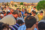 Syrians pray at a cemetery in Tall Rifat village near Aleppo on Saturday, June 23, 2012 - during the burial of 70-year-old Amina Ahmed Kabso, who was killed in the latest spate of violence in northern Syria. Kabso was reportedly killed while traveling from Aleppo to her home in Tall Rifat when Syrian security forces targeted the mini-bus she was in. (Photo by Vudi Xhymshiti)