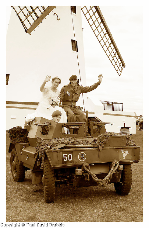 Wedding Armoured Car, The Bride and Groom andy and Kath arrive for picture at the Windmill on Lytham Green in Andys Dingo Scout car after the couple were wed at at Saint John The Divine Church Lytham during the  Lytham 1940's war weekend..19 August 2011  Image © Paul David DrabbleAndy and Kaths 1940s Wedding Lytham War Weekend August 2011 Image © Paul David Drabble