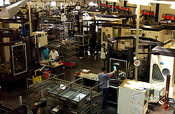 HERSTAL, BELGIUM - JUNE-13-2003 - Technicians work witn state of the art computer controled lathes that cut the highest quality metals into gun barrles at the FN Herstal weapons fabrication plant near Liege, Belgium. (PHOTO © JOCK FISTICK)