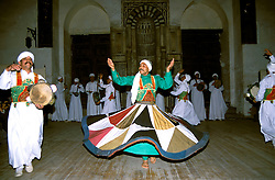 Egypt, Cairo. Whirling dervish dancers. Photo: egypts006.Photo copyright Lee Foster, 510/549-2202, lee@fostertravel.com, www.fostertravel.com