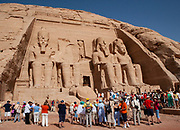 Temple of King Rameses II in Abu Simbel, Nubia, Egypt with tourists. Moved up from the water's edge in 1964 to prevent being innundated by Lake Nasser