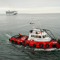 Tug boats help ships to dock in Strait of Magellan, at Punta Arenas, Chile.