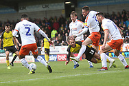 Burton Albion midfielder Marcus Harness (16) is crowded out during the EFL Sky Bet League 1 match between Burton Albion and Luton Town at the Pirelli Stadium, Burton upon Trent, England on 27 April 2019.
