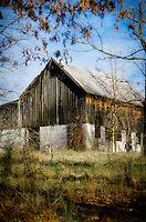 A classic old barn sits upon a hill overlooking the grounds.