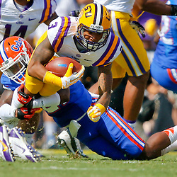 Oct 12, 2013; Baton Rouge, LA, USA; LSU Tigers wide receiver Odell Beckham (3) is tackled by Florida Gators defensive back Jabari Gorman (21) during the first quarter of a game at Tiger Stadium. Mandatory Credit: Derick E. Hingle-USA TODAY Sports