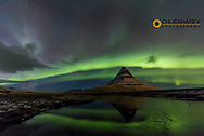Aurora borealis reflects below Kirkjufell aka Church Mountain on the Snaefellsnes Peninsula in western Iceland
