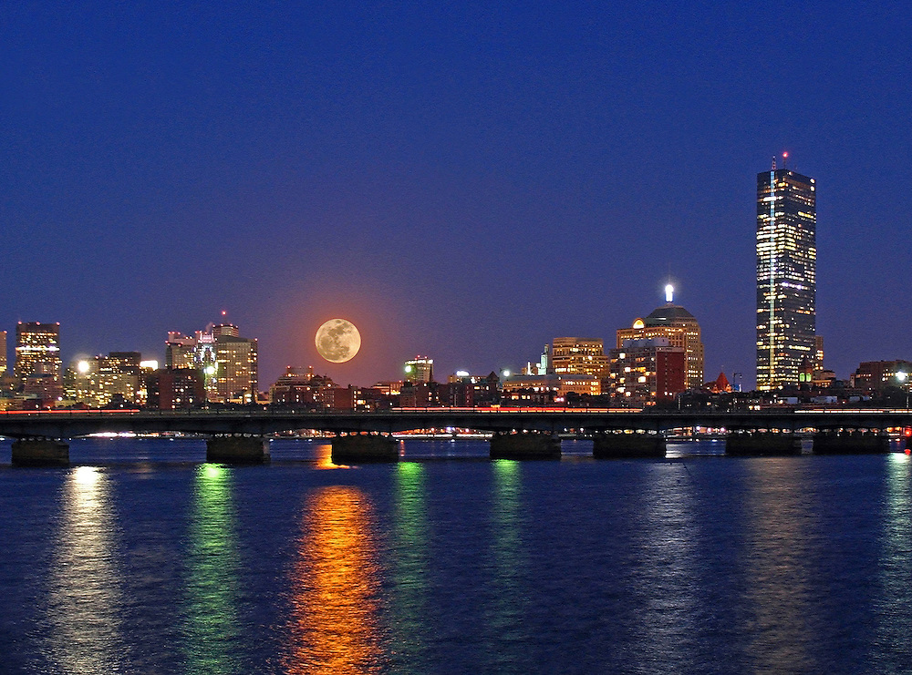 New England nature and astrology photography of the rising super moon over the Boston skyline with the full moon reflection in the Charles River. The full moon was quickly rising across the Boston Beacon Hill area and the Massachusetts Avenue bridge and making its way towards the John Hancock Tower. Boston nightscape and fullmoon are beautifully reflected in the Charles River while the magical blue twilight is still present. What a treat and pleasure to have experienced and photographed this astronomical phenomena. Next one up 14 November 2016.<br /> <br /> Super moon is known as a new or full moon occurring at the same time the moon comes within 90 percent of its closest approach to Earth in a given orbit. It is an astronomical event that happens 4-6 times a year, but according to a NASA Science News story, last nights full moon nearly coincided with the moon's arrival at its closest point in its orbit around the Earth, resulting in the biggest, visible full moon in North America in two decades. Next super moon to watch November 14, 2016 ... mark your calendars.<br /> <br /> Boston super moon photos are available as museum quality photography prints, canvas prints, acrylic prints or metal prints. Fine art prints may be framed and matted to the individual liking and decorating needs:<br /> <br /> http://juergen-roth.pixels.com/art/supermoon<br /> <br /> All Boston skyline photos are available for digital and print image licensing at www.RothGalleries.com. Please contact me direct with any questions or request.<br /> <br /> Good light and happy photo making!<br /> <br /> My best,<br /> <br /> Juergen<br /> Prints: http://www.rothgalleries.com<br /> Photo Blog: http://whereintheworldisjuergen.blogspot.com<br /> Instagram: https://www.instagram.com/rothgalleries<br /> Twitter: https://twitter.com/naturefineart<br /> Facebook: https://www.facebook.com/naturefineart