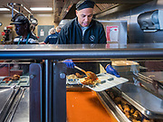 27 NOVEMBER 2019 - DES MOINES, IOWA: US Senator CORY BOOKER (D-NJ) plates up chicken and spaghetti in the kitchen at Central Iowa Shelter and Services in Des Moines. Sen Booker helped plate up and serve lunch at the shelter. The shelter has about 180 beds and is full almost every night. In January and February, more than 250 people per night come to the shelter, which sets out overflow bedding. Senator Booker is running to be the Democratic nominee for the US Presidency in 2020. Iowa hosts the first selection event of the presidential election season. The Iowa caucuses are February 3, 2020.        PHOTO BY JACK KURTZ