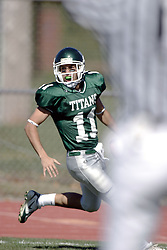 07 October 2006: Titan QB Nick Panno crosses the goal line under the up-streched arms of an official signaling a TD. The Titans of Illinois Wesleyan University started off strong with a touchdown on the 2nd play from scrimmage in the game.  The Titans led most of the way, but failed to maintain the lead in the 4th quarter giving up the decision of this CCIW conference game to the Red Men of Carthage by a score of 31 - 28. Action was at Wilder Field on the campus of Illinois Wesleyan University in Bloomington Illinois.<br />