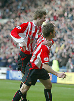 Photo. Andrew Unwin.<br /> Sunderland v Sheffield United, FA Cup Sixth Round, Stadium of Light, Sunderland 07/03/2004.<br /> Sunderland's Tommy Smith (r) is congratulated by teammate George McCartney (l) after scoring the first goal of the game.