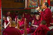 Buddhist nuns read and go through their daily routines at the Lhasaani Tsang Kung Nunnery in Lhasa, Tibet.