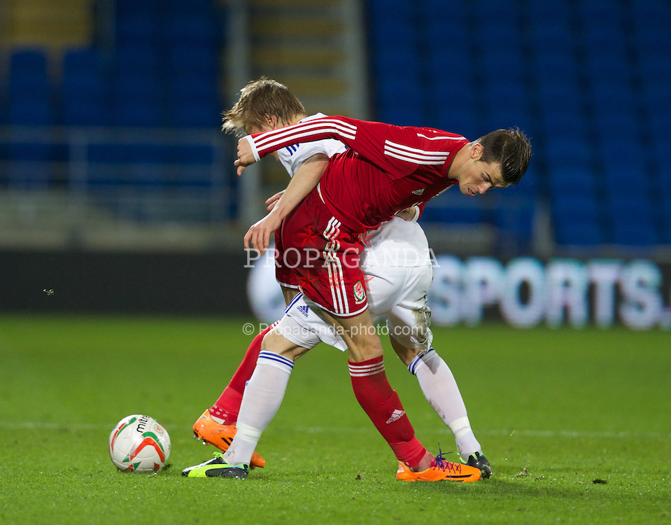 CARDIFF, WALES - Saturday, November 16, 2013: Wales' Gareth Bale in action against Jere Uronen of Finland during an International Friendly match at the Cardiff City Stadium. (Pic by Kieran McManus/Propaganda)