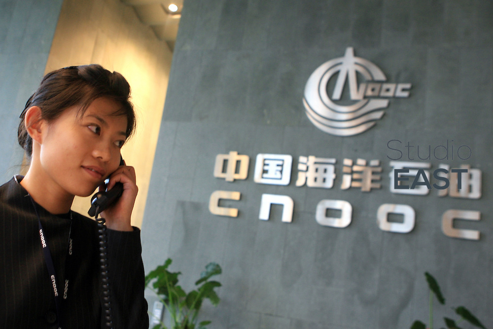 BEIJING, CHINA - July 18: A CNOOC employee makes a phone call in the company's headquarters on July 18 (Tuesday), 2006 in Beijing, China. (Photo by Servais Mont/Getty Images)