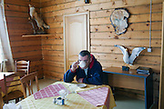 Altai Region, Siberia, Russia, 25/02/2011..A man drinks tea in the cafe at the Kaimskoe leisure resort, part owners of the proposed Siberian Coin casino project in the Altai mountains.