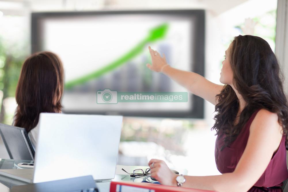 Businesswoman pointing to graph (Credit Image: © Image Source/Albert Van Rosendaa/Image Source/ZUMAPRESS.com)