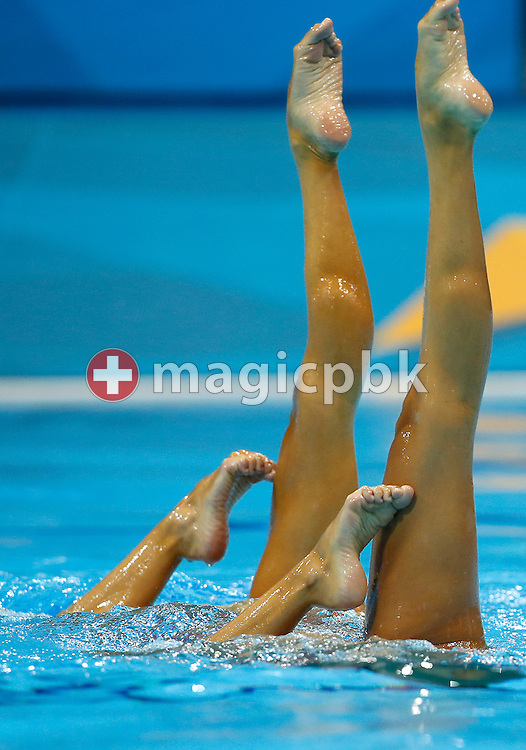 Canada's Marie-Pier Boudreau Gagnon and Canada's Elise Marcotte perform in the Duet Technical Routine during the Synchronized (Synchronised) Swimming competition held at the Aquatics Center during the London 2012 Olympic Games in London, Great Britain, Sunday, Aug. 5, 2012. (Photo by Patrick B. Kraemer / MAGICPBK)