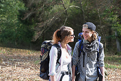 Young couple hiking in a forest and smiling, Bavaria, Germany