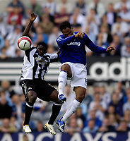 Photo: Jed Wee.<br /> Newcastle United v Everton. The Barclays Premiership. 24/09/2006.<br /> <br /> Everton's Joleon Lescott (R) jumps with Newcastle's Obafemi Martins.
