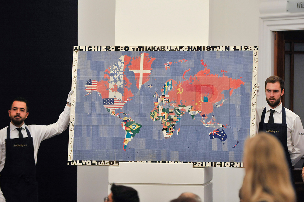© Licensed to London News Pictures. 05/10/2017. London, UK.  'Mappa', 1983, by Alighiero Boetti sold for a hammer price of GBP700k (Est. GBP800-1,200k) at the Italian and Contemporary Art evening auction at Sotheby's, New Bond Street, coinciding with the opening of the London's Frieze Art Fair. Photo credit : Stephen Chung/LNP