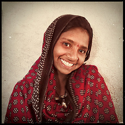 "iPhone portrait of Ashu Kumari, 12, in a village outside of Banswara, Rajasthan, India, April 5, 2013. ""I would not feel good if I got married at a young age. I would not feel good having a child at a tender age. I would not feel good if my children were born while I am still a girl,"" said Kumari. <br />  <br /> Under Indian law, children younger than 18 cannot marry. Yet in a number of India's states, at least half of all girls are married before they turn 18, according to statistics gathered in 2012 by the United Nations Population Fund (UNFPA). However, young girls in the Indian state of Rajasthan—and even a few boys—are getting some help in combatting child marriage. In villages throughout Tonk, Jaipur and Banswara districts, the Center for Unfolding Learning Potential, or CULP, uses its Pehchan Project to reach out to girls, generally between the ages of 9 and 14, who either left school early or never went at all. The education and confidence-building CULP offers have empowered youngsters to refuse forced marriages in favor of continuing their studies, and the nongovernmental organization has provided them with resources and advocates in their fight."