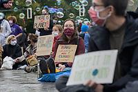 """25 SEP 2020, BERLIN/GERMANY:<br /> Junge Frau mit Schild """"Human change not Climate change"""", Fridays for Future Demonstration fuer Massnahmen gegen den Klimawandel, Brandenburger Tor, Strasse des 17. Juni<br /> IMAGE: 20200925-01-002<br /> KEYWORDS: Protest, Demonstrant, Demonstranten, Schueler, Schüler, Klimakatastrophe, FFF, Mundschutz, Mund-Nase-Schutz, Abstand"""