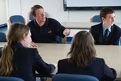 Teacher and his class in an informal discussion group,