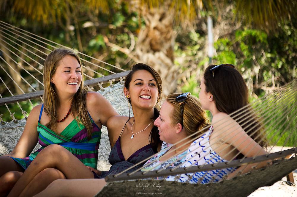 Friends, and at times roommates, chat in a hammock during the BBQ picnic that was put together for the families the day before graduation.