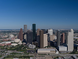Aerial view of daytime Houston, Texas skyline with clear skies.