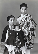 formal portrait of two Japanese women with new born baby 1965