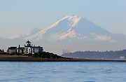 The mountain is out! Mount Rainier looms in the distance as seen from a boat near the West Point Lighthouse in Seattle. (Greg Gilbert / The Seattle Times)
