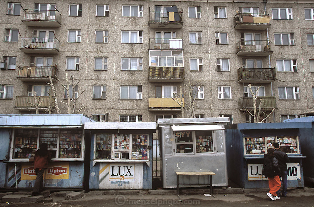 Kiosks selling sundries and snacks outside apartments in Ulaanbaatar, Mongolia. (Supporting image from the project Hungry Planet: What the World Eats)