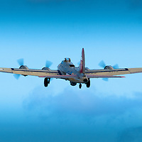 From The Collings Foundation website:  Made famous in its role in the Daylight Strategic Bombing Campaign of WWII and the post-war movies that made it an icon, the B-17 flies proudly across the United States with its companion, the B-24 Liberator on a mission of peace and remembrance. No longer avoiding anti-aircraft fire or the terror of enemy fighters, the B-17 stands as a living history exhibit for the nation as it flies on the annual Wings of Freedom Tour into over 130 cities annually. ..One of only fourteen B-17s still flying in the United States, the rare B-17 gives the citizens of the communities it visits a chance see how it was like so long ago. It gives our WWII veterans the chance to talk about their experiences with a backdrop that brings their stories alive and educates a generation that may have never heard of their experiences as they fought for freedom. .This particular aircraft was built by Douglas Aircraft Manufacturers in Long Beach, California, April of 1945.