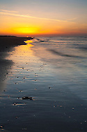Sunset over the beach at Titchwell nature reserve, Norfolk, Uk