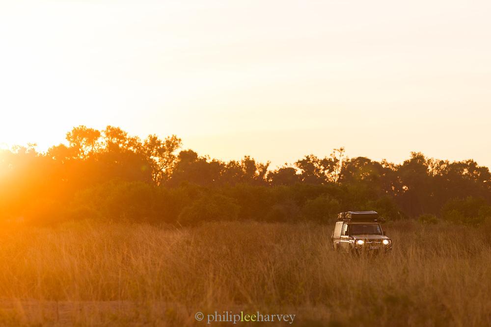 Safari 4x4 in field at sunrise in South Luangwa National Park, Zambia