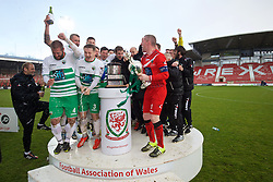 WREXHAM, WALES - Monday, May 2, 2016: The New Saints' players celebrates with the trophy after the 2-0 victory over Airbus UK Broughton during the 129th Welsh Cup Final at the Racecourse Ground. Phil Baker, Chris Marriott, goalkeeper Paul Harrison. (Pic by David Rawcliffe/Propaganda)