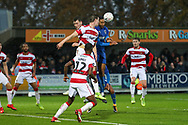 Doncaster Rovers midfielder Madger Gomes (12) watches AFC Wimbledon defender Terell Thomas (6) battles for possession during the The FA Cup match between AFC Wimbledon and Doncaster Rovers at the Cherry Red Records Stadium, Kingston, England on 9 November 2019.