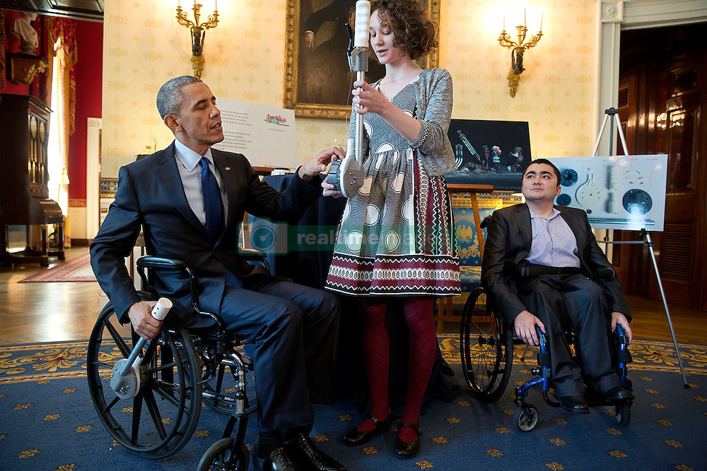 President Barack Obama views science exhibits during the 2015 White House Science Fair celebrating student winners of a broad range of science, technology, engineering, and math (STEM) competitions, in the Blue Room, March 23, 2015. The President speaks with Mohammed Sayed, right, and Kaitlin Reed, 16-year-old students from Cambridge and Dover, Mass., respectively. Wheel-chair bound himself, Mohammed developed a 3D-printed modular arm for his wheelchair that can serve as a food tray, camera tripod, rain canopy, laptop holder, and cup holder, and Kaitlin developed an attachable lever that can make wheelchair movements easier and less tiring. (Official White House Photo by Pete Souza)<br /> <br /> This official White House photograph is being made available only for publication by news organizations and/or for personal use printing by the subject(s) of the photograph. The photograph may not be manipulated in any way and may not be used in commercial or political materials, advertisements, emails, products, promotions that in any way suggests approval or endorsement of the President, the First Family, or the White House.
