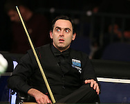Ronnie O'Sullivan of England looks on during his match against Tian Pengfei . Betvictor Welsh Open snooker 2016, day 2 at the Motorpoint Arena in Cardiff, South Wales on Tuesday 16th Feb 2016.  <br /> pic by Andrew Orchard, Andrew Orchard sports photography.