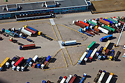 Nederland, Zuid-Holland, Maasvlakte, 23-05-2011; files van vrachtauto's met containers, parkeerterrein en toegang tot terminal van ECT en APM. .Traffic jam of trucks carrying containers at the parking of the container terminals of ECT and APM in the Port of Rotterdam...luchtfoto (toeslag), aerial photo (additional fee required).copyright foto/photo Siebe Swart