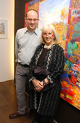 DAMIAN ELWES and his mother TESSA KENNEDY at a private view of artist Damian Elwes work 'Artists Studios' held at Scream, 34 Bruton Street, London W1 on 29th June 2006.<br /><br />NON EXCLUSIVE - WORLD RIGHTS