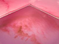Aerial view of Hutt Lagoon pink salt bed lake in Yallabatharra, Australia.