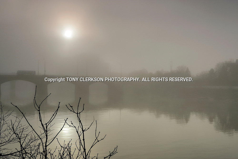 Atmospheric scenes as the Sun tries to break through the murk on the River Clyde as Glasgow is shrouded in fog
