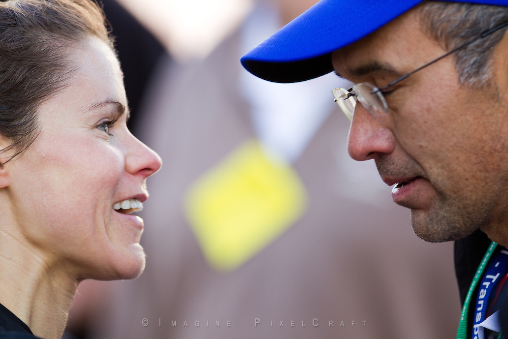 Krista Vrombaut talks with Joe Moreno after crossing the finish line. These are images of the Start and Finish Line at the Quad Cities Marathon in 2010. This important sporting event is growing each year. These photographs show the intensity as well as the fun of this athletic event.