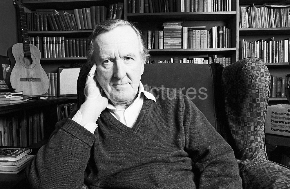 A portrait of English poet, lecturer, actor and broadcaster Patrick J. Kavanagh. We see him in miffle-distance seated in his favourite armchair while at home in the Cotswolds, Gloucestershire, England. P J Kavanagh (born 6 January 1931) is the author of eight books of poems, an essayist and travel-writer, a novelist, and editor of the poems of Ivor Gurney; he has received the Cholmondely Award for Poetry, the Guardian Fiction Prize, and the Richard Hillary Prize for his memoir The Perfect Stranger. In addition to this literary career, he has been an actor, lecturer, journalist and broadcaster, all after serving in the Army during the Korean War, where he was wounded in action.