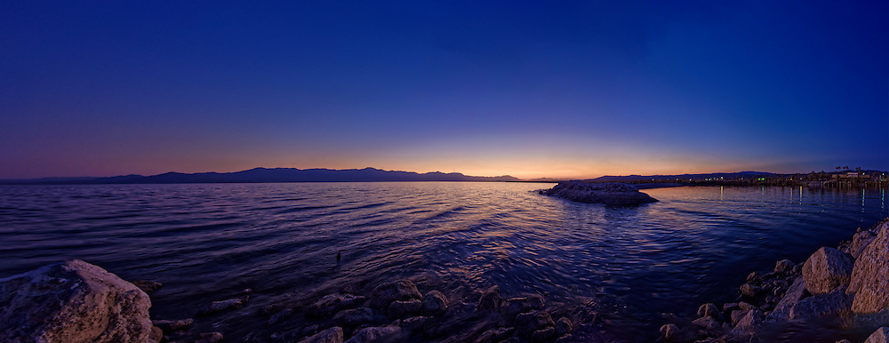 A Full Spectrum panoramic image of sunset at the North Shore Beach of Salton Sea in Mecca, CA.